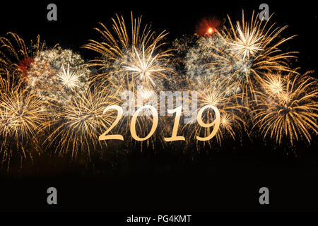 2019 Happy New Year celebration golgen fireworks. New year and holidays concept. - Stock Photo