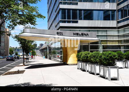 New York City, USA - June 21, 2018: Modernist door canopy at the entrance of a modern architecture residential building in 57th street in Manhattan - Stock Photo