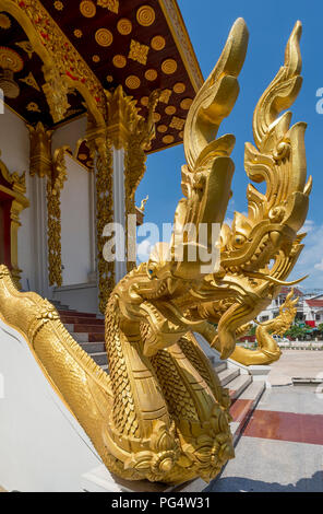Beautiful naga at the entrance to a Buddhist temple in Vientiane, Laos - Stock Photo