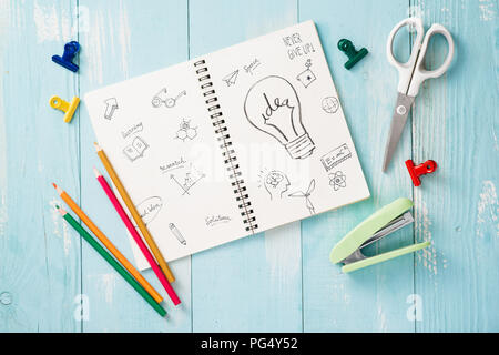 Paper tape roll, paper clips, and notepads laying on a wooden table, School supplies, Office supplies, Back to school - Stock Photo
