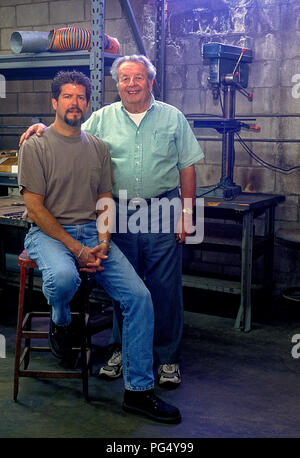 Nick Arias Jr. (Right) and son at Arias Pistons factory  in California. 05/2000 - Stock Photo