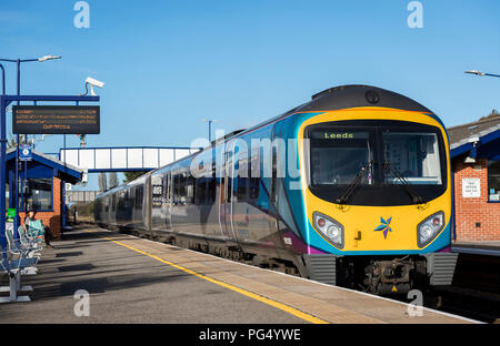 Transpennine Express Class 185 passenger train waiting at a platform at a railway station on it's way to Leeds. - Stock Photo