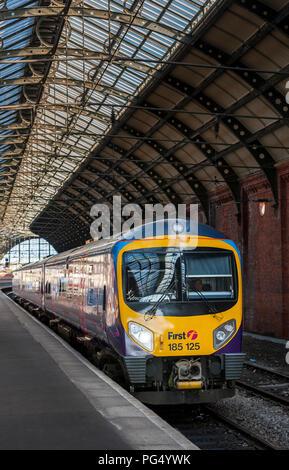 First Transpennine Express Class 185 passenger train waiting at a platform at a railway station, England. - Stock Photo