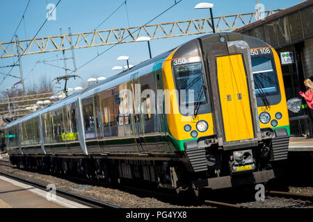 London Midland trains passenger train class 350 travelling at a station on the Abbey Line, Hertfordshire, UK. - Stock Photo