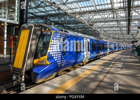 ScotRail Class 380 Desiro passenger train waiting at a station in the UK. - Stock Photo