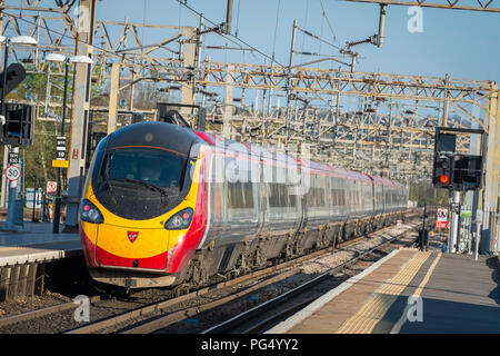 Virgin Trains pendolino class 390 electric high speed train at a railway station on the Abbey Line, Hertfordshire, UK. - Stock Photo