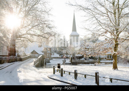 Eynsford bridge, ford and church in the snow - Stock Photo