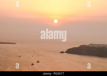 Santorini sunset over the Caldera towards Oia - Stock Photo
