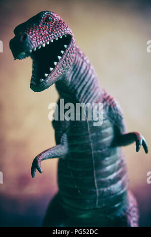 Still life of a toy Tyrannosaurus rex dinosaur - Stock Photo