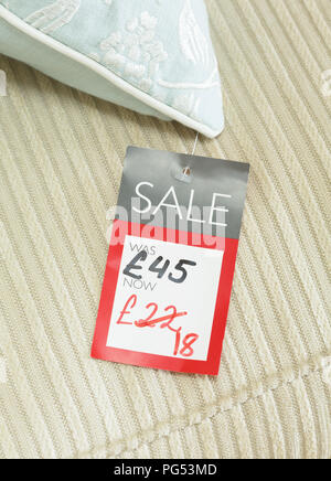 Mock-up of price tag showing reduced price of a discounted product for sale in a retail store. Priced in pounds sterling for UK market - Stock Photo