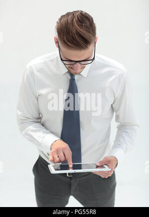 close up.modern business man by tapping the screen of digital tablet - Stock Photo