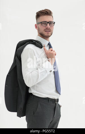 side view .confident businessman with a jacket over his shoulder. - Stock Photo