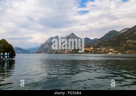 Lake Iseo and the surrounding mountain range. Italy - Stock Photo