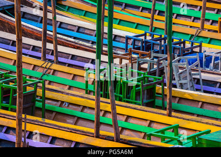 Colorful long wooden boats for tourists at pier in Nyaungshwe, Myanmar. 28 of feb. 2015 - Stock Photo