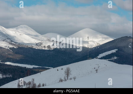 Morning winter snow covered scenery picturesque alp mountain ridge (Ukraine, Carpathian Mountains, Chornohora Range, tranquility peaceful view from Dz - Stock Photo
