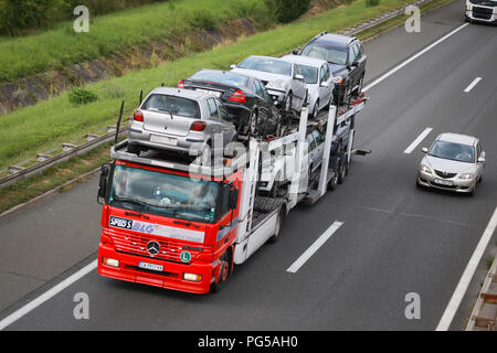 Zagreb, Croatia - August 11th, 2018 : Car transport truck filled up with used cars driving on Zagreb motor way bypass in Zagreb, Croatia. - Stock Photo