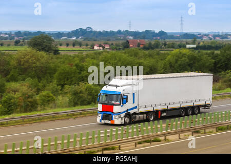 Close up of speeding lorry cargo truck with trailer on the Zagreb motor way bypass in Zagreb, Croatia. - Stock Photo