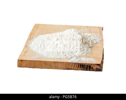 Wheat flour white on a wooden chopping board - Stock Photo