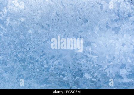 Natural beautiful ice pattern on frosty glass. - Stock Photo