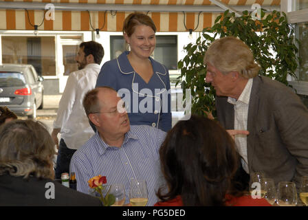 Berlin, DEU, 07.07.2011: Celebration for Peer Steinbrueck: Anne Steinbrueck say hello to her father Peer Steinbrueck, politician and chancellor candidate and bestseller-author (Germany) - Stock Photo