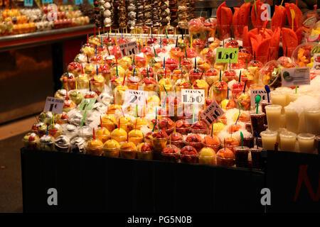 BARCELONA, SPAIN - JULY 13, 2018: fruits and vegetables stall in Barcelona Market (Mercat de Sant Josep de la Boqueria), a large public market with en - Stock Photo
