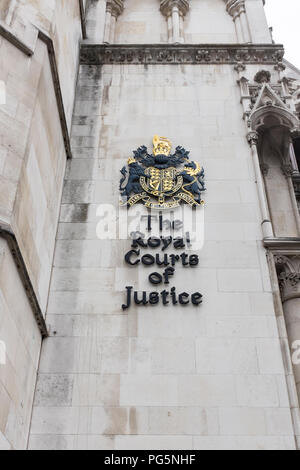The Royal Courts of Justice in the Strand, London which houses victorian law courts - Stock Photo