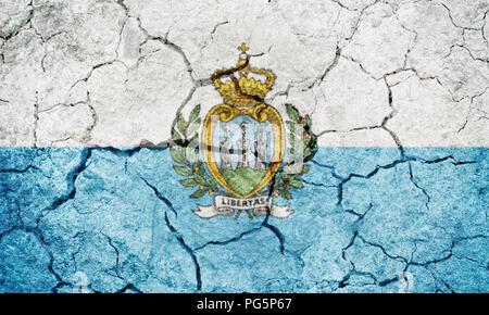 Republic of San Marino flag on dry earth ground texture background - Stock Photo