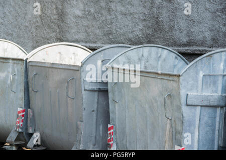 Row of urban steel containers for garbage - Stock Photo