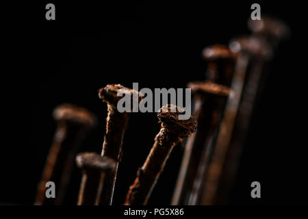 close up view of vintage rusty nails isolated on black - Stock Photo