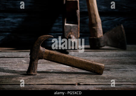 selective focus of vintage carpentry tools arranged on wooden tabletop - Stock Photo