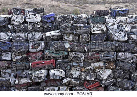 Demolished car wrecks piled up in scrapyard, Tenerife Canary Islands Spain. - Stock Photo