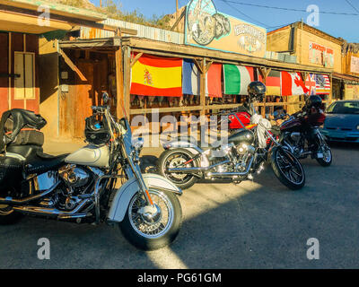 Motorcycles parked in front store of  main street in Oatman, Arizona on Route 66. - Stock Photo