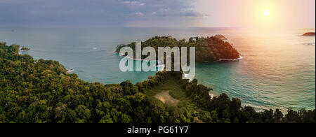 Sunset, Corcovado National Park, Osa Peninsula, Costa Rica. This image is shot using a drone. - Stock Photo