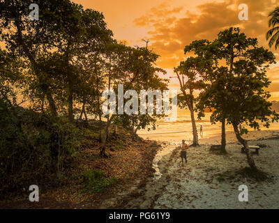 People enjoying the Sunset on the Beach, Corcovado National Park, Osa Peninsula, Costa Rica. This image is shot using a drone. - Stock Photo