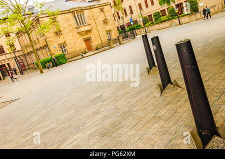 Bollards pushing through the stone floor near the Laing Art Gallery in Newcastle, England, UK - Stock Photo