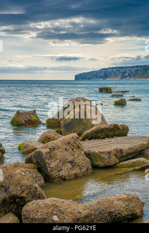 Filey bay Beach on Yorkshire coast near Reighton Gap and Speeton at sunrise - Stock Photo