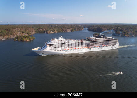 Lidingo, Sweden - July 31, 2018: Aerial view of the cruise ship MSC Preziosa operated by MSC Cruises leaving Stockholm on a 15 days, round-trip Northe - Stock Photo