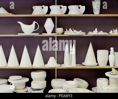 Products on shelf in porcelain workshop - Stock Photo