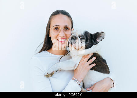 Portrait of woman next to her dog - Stock Photo