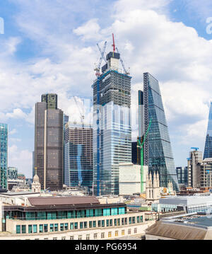 City of London changing skyline: 22 and 100 Bishopsgate under construction between Tower 42 and the Cheesegrater, financial and insurance district - Stock Photo