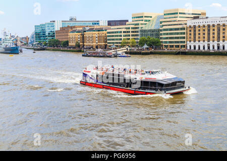 City Cruise riverboat sailing on the River Thames in the Pool of London on a popular tourist sightseeing cruise in summer viewed from London Bridge - Stock Photo