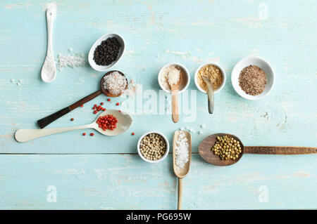 Various sorts of salt and various sorts of pepper - Stock Photo