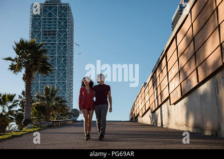 Spain, Barcelona, couple walking in the city - Stock Photo