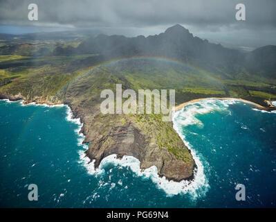USA, Hawaii, Kauai, rainbow over Na Pali Coast, aerial view - Stock Photo