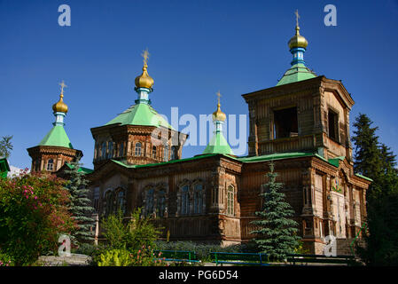 The wooden Holy Trinity Russian Orthodox Cathedral, Karakol, Kyrgyzstan - Stock Photo