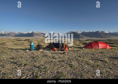 Camping above Lake Zorkul, with the Great Pamir Range in Afghanistan behind,Tajikistan - Stock Photo
