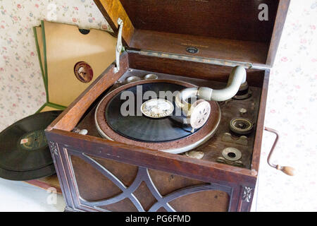 Gramophone playing 'Danny Boy' in a worker's cottage preserved at Blaenavon Ironworks, now a museum and UNESCO World Heritage Site in Gwent, Wales, UK - Stock Photo