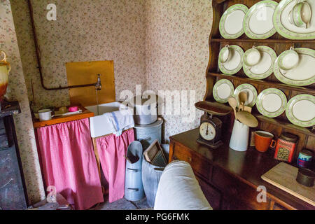 Interior of a worker's cottage downstairs room preserved at Blaenavon Ironworks, now a museum and UNESCO World Heritage Site in Gwent, Wales, UK - Stock Photo
