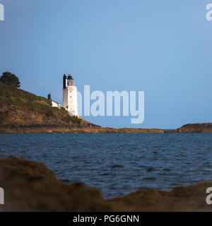 St Anthony's lighthouse marking the eastern point of the entrance to Falmouth Harbour, in Cornwall, southern England, United Kingdom - Stock Photo