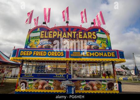 Cheboygan, Michigan, USA - August 9, 2018: Fair concessions booth at the Cheboygan County Fair in northern Michigan. - Stock Photo